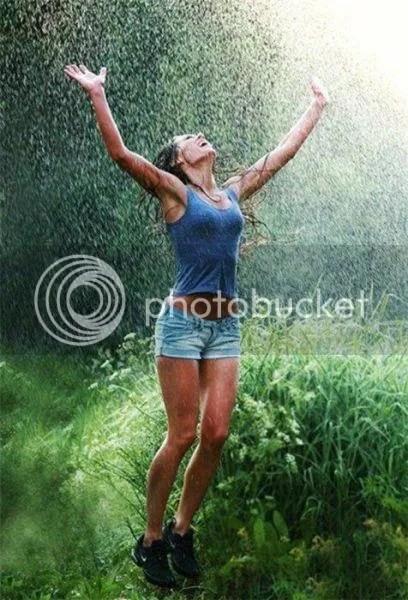 woman rejoicing in rain