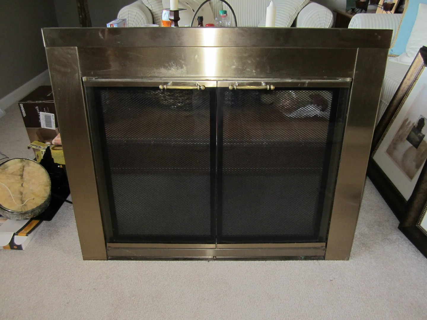 Update Fireplace Doors With Spray Paint / HomeStagingBloomingtonIL