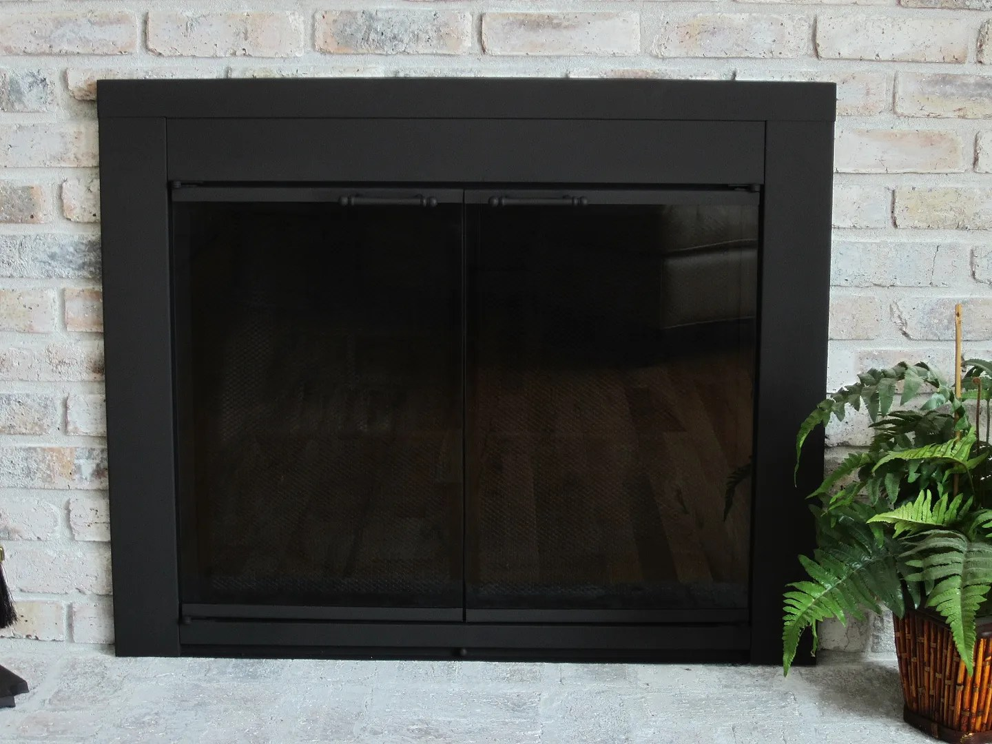 Spray painting a fireplace screen black | Home Staging In ...