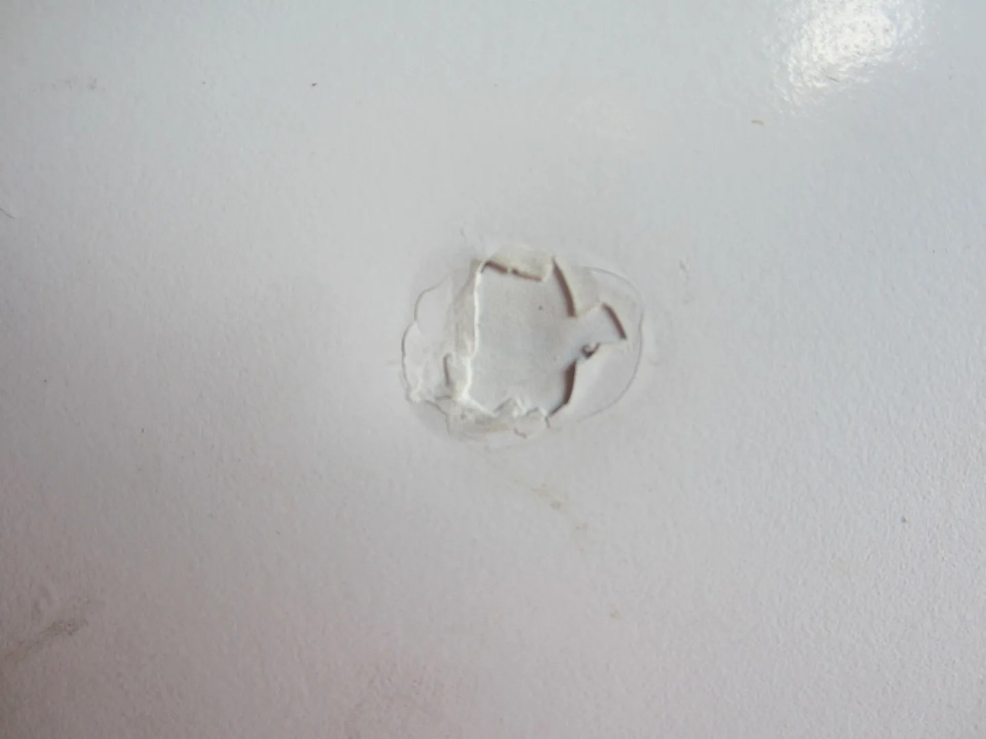 Repairing Dings And Scratches In A Metal Door Home