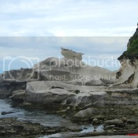 Burgos Wind Farm and Kapurpurawan Rock Formation: A Seamless Synergy of Nature and Technology