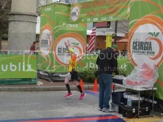 Me crossing the finish line of the Publix Georgia Marathon - Atlanta, Georgia