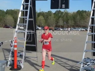 Me crossing the finish line of the Making Tracks for Celiacs 5K - Birmingham, Alabama