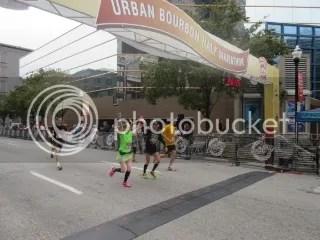 Me crossing the finish line with Natalie at the Urban Bourbon Half Marathon, Louisville, Kentucky