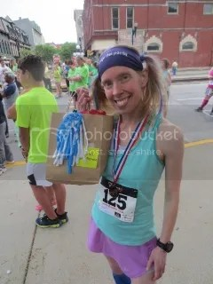 Me with my bronze medal and bag of goodies for being the 3rd Overall Female at the Pro.Active For Life 5K - Frankfort, Kentucky