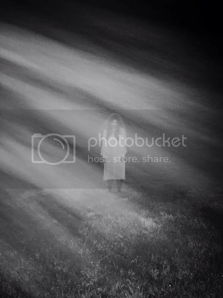 Ghostly woman in field