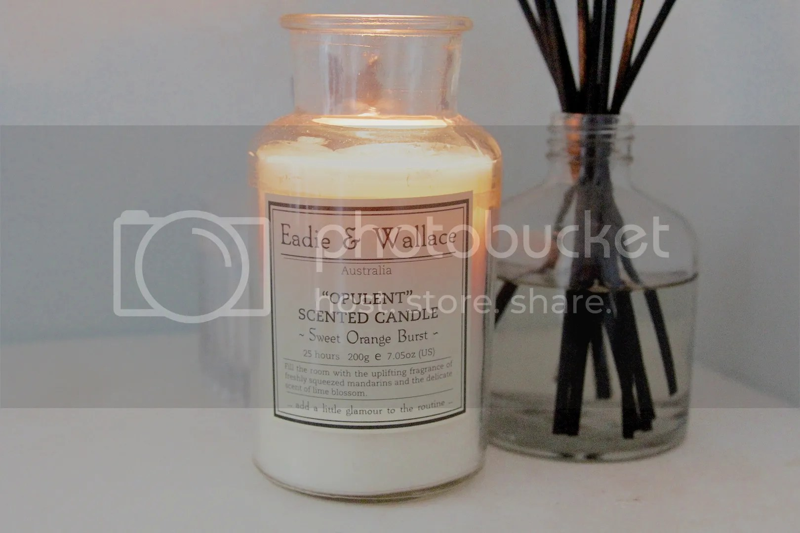 Orange oil scented candle and vanilla scented room diffuser