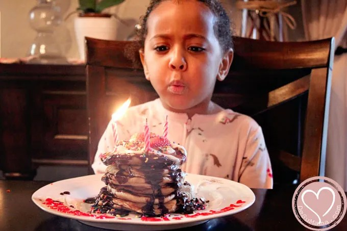 birthday traditions, birthday celebrations, interracial family, biracial baby, multiracial family, bicultural family, black father