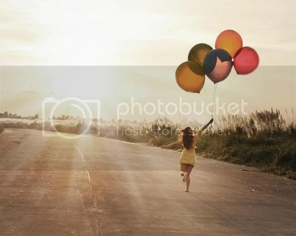Bloggeretterized Girl Walking to Horizon with Balloons
