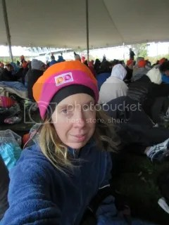 Me sitting in the tent for the Orange Start Village before the TCS New York City Marathon...rocking the free Dunkin Donuts Hat.  I was, honestly, freezing!
