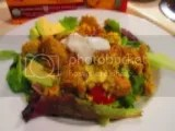A delicious salad topped off with Qrunch Classic Curry with Lentils Quinoa Burger