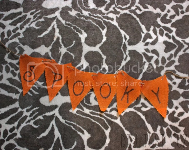 Creating your own Halloween decor has never been easier than with this Spooky Halloween Bunting tutorial! Use your silhouette & freezer paper in ways you'd never expect! @diyjustcuz www.diyjustcuz.com