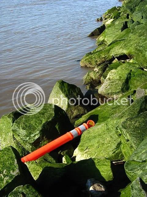 Hazard marker in the rocks, Hudson River