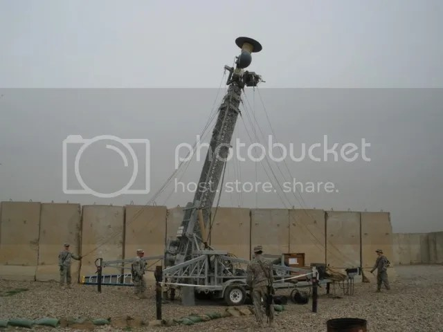 A Raytheon Rapid Aerostat Initial Deployment tower, which is part of the Base Expeditionary Targeting System of Systems-Combined, is raised on a base.