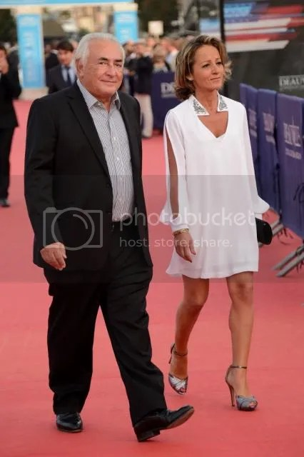 DEAUVILLE, FRANCE - SEPTEMBER 13: Dominique Strauss-Kahn and Myriam L'Aoufir arrive at the closing ceremony and the 'Sin City : A Dame To Kill For' premiere during the 40th Deauville American Film Festival on September 13, 2014 in Deauville, France