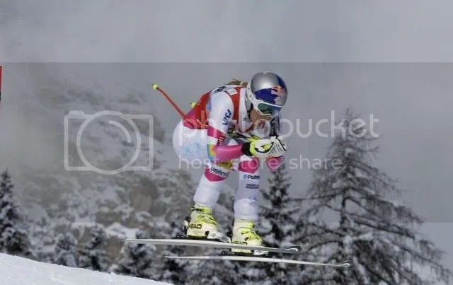 Lindsey Vonn of the U.S. is airborne as she clears a gate to win the women's World Cup Downhill skiing race in Cortina D'Ampezzo January 18, 2015..