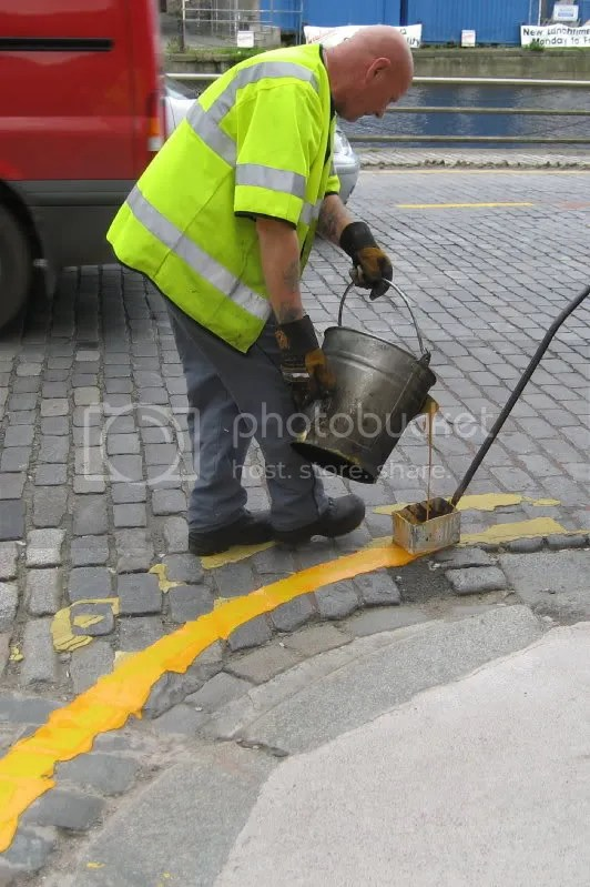 close up of workman with bucket
