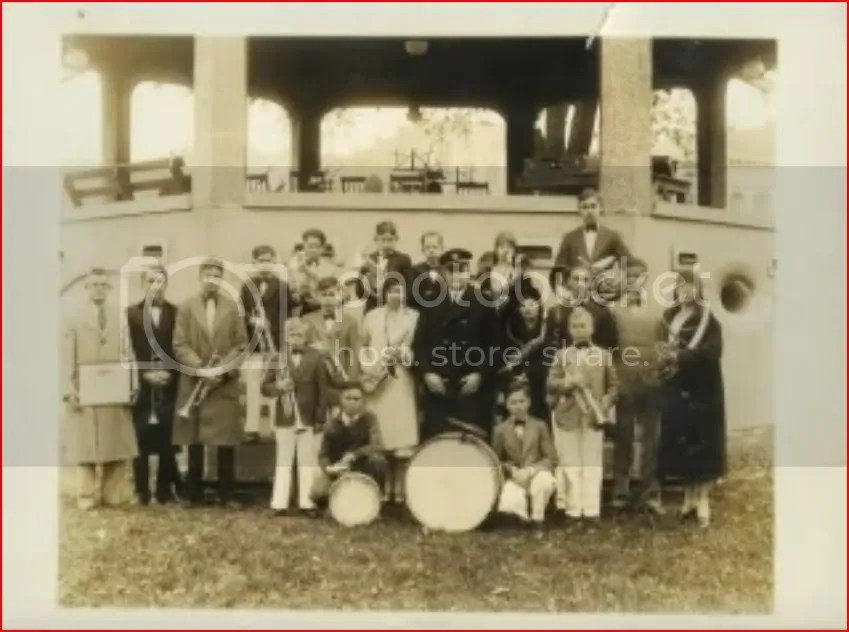 What seems to be the school band.  Earl is probably the lad behind the right shoulder of the band leader.