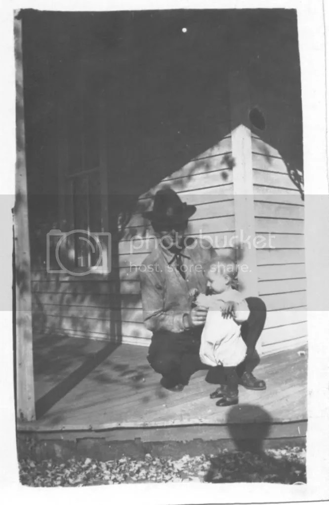 Earl with his father, about 1918, apparently on the porch of their Lowry City home