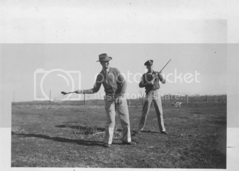 Earl and his father shooting clay targets, Lowry City, March 1945