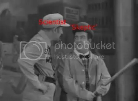 A still from Abbott and Costello's classic 'Who's on First?' sketch; Abbott wears a scientist hat, Costello has a skeptic one.