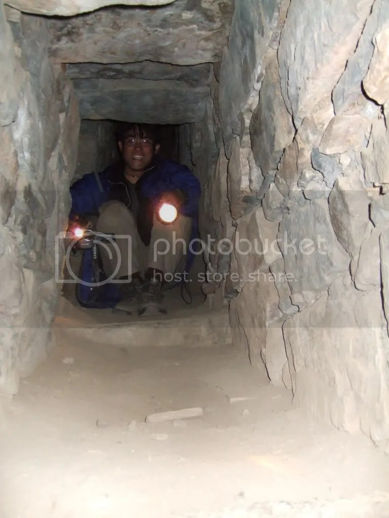The author stuck between rocks and a hard place inside the tunnel.