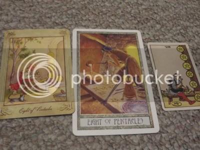 photo by author Juli D. Revezzo, decks Llewellyn Tarot (copyright Llewellyn), Druid Craft Tarot by Philip Carr-Gomm and Stephanie Gomm, Smith-Waite Centennial Tarot Deck (copyright US Games)