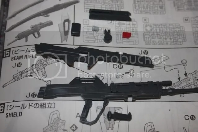 Parts for his beam rifle. Pretty standard issue rifle here, nothing special