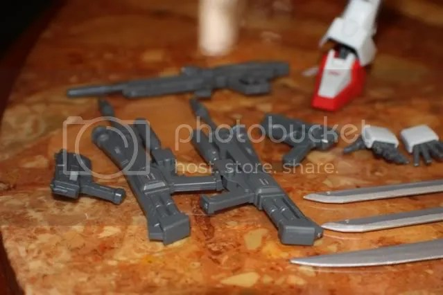 5 rifles altogether. 2 Beam rifles with grenade launchers, 1 Beam rifle and 2 Beam Shorties(I just call them handguns)