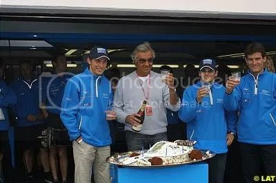 Button (L) and Briatore (Center) in happier times at Benetton in 2001.  Fisichella (R) and Webber (Far Right) also present