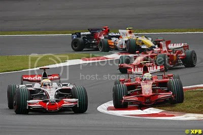 Massa forced onto the grass by Hamilton