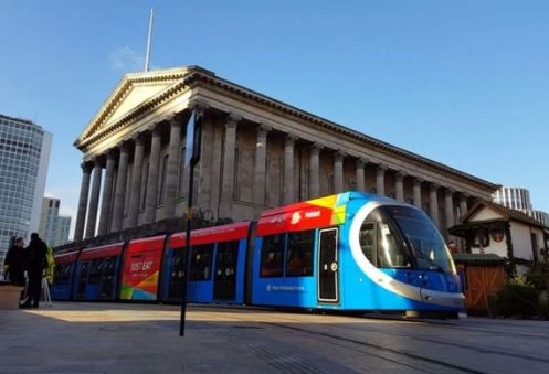 A Midland Metro tram on the new line past Birmingham Town Hall