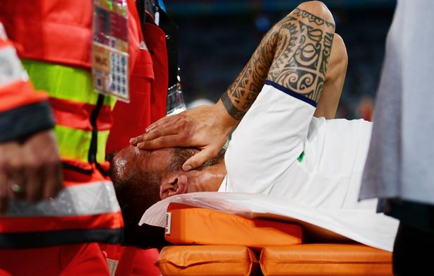 Painful memories for Trevor Francis: Italy defender Leonardo Spinazzola covers his face after injuring his achilles during the Euro 2020quarter-final match with Belgium at the Allianz Arena in Munich on Friday, July 2, 2021