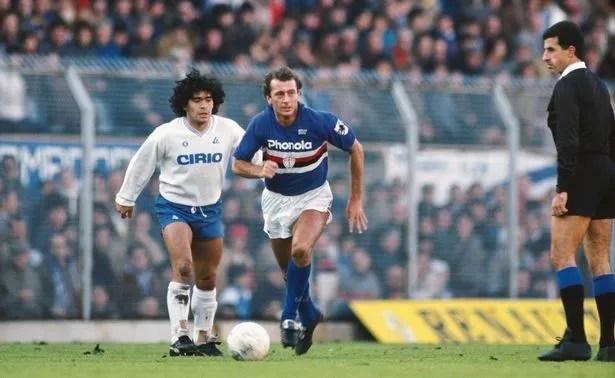 Napoli star Diego Maradona watches Sampdoria's Trevor Francis on the ball in 1984