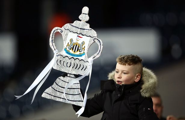 Newcastle United fan brandishes FA Cup trophy from aluminum foil during FA Cup fifth game at Hawthorns