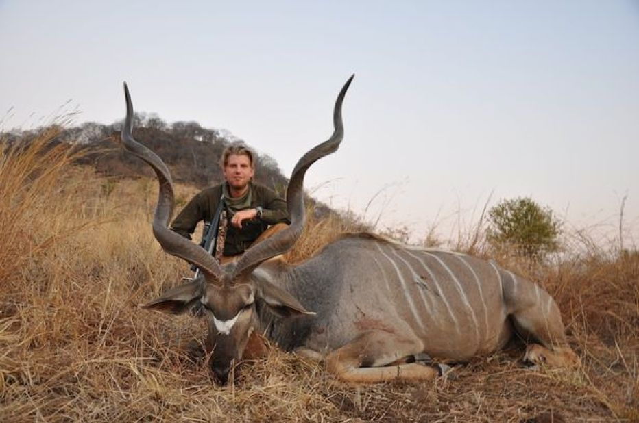 Eric Trump proudly poses with a dead antelope