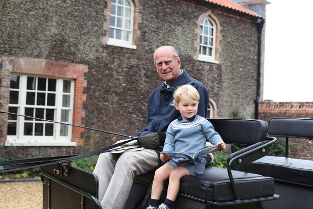Prince Philip with his great-grandson Prince George on a carriage