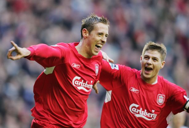 Peter Crouch (L) celebrates with Stephen Gerrard of Liverpool after he scores the second goal during the Barclays Premiership match between Liverpool and Wigan Athletic at Anfield on December 3, 2005 in Liverpool, England.