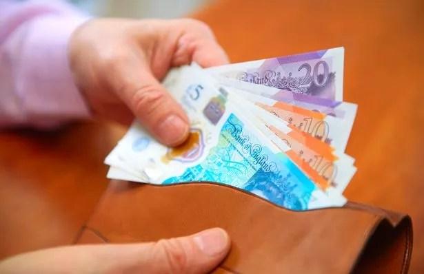 Wallet full of UK money
