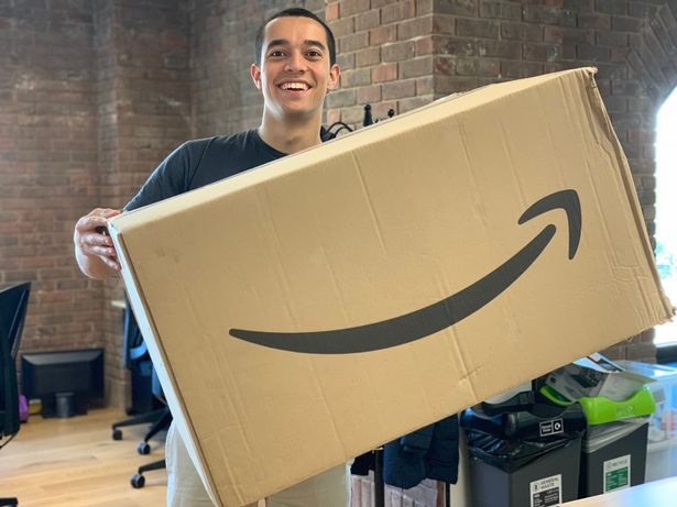 Tom Church poses with his Amazon bargains