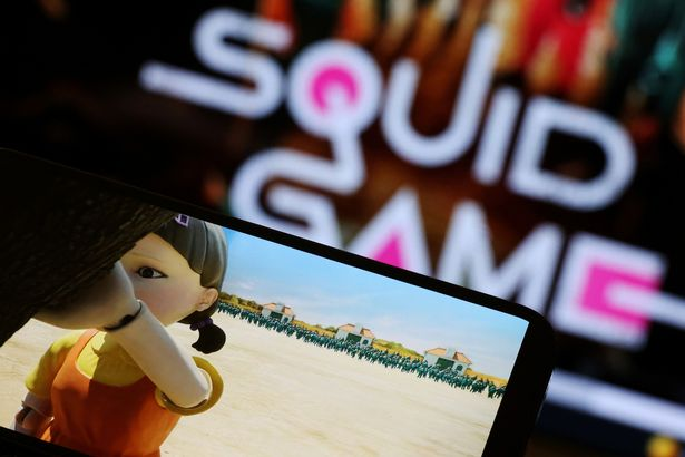 """The Netflix series """"Squid Game"""" is played on a mobile phone in this picture illustration"""