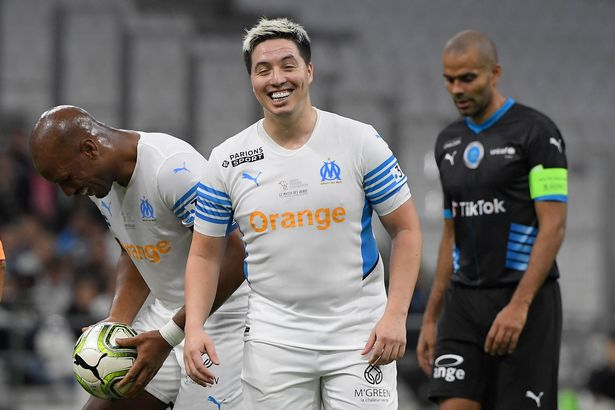 """French former player Samir Nasri reacts during the charity """"Heroes"""" football match between former Olympique de Marseille's players and Team Unicef, at the Velodrome stadium in Marseille, southern France, on October 13, 2021."""