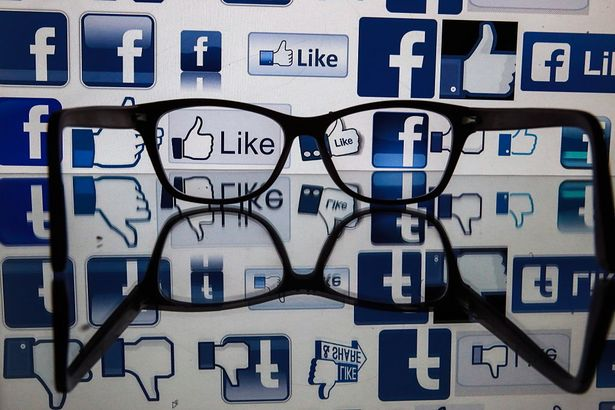 ST PETERSBURG, RUSSIA - NOVEMBER 16, 2016: Glasses on a reflective surface in front of a computer screen showing Facebook logos. Sergei Konkov/TASS (Photo by Sergei Konkov\TASS via Getty Images)