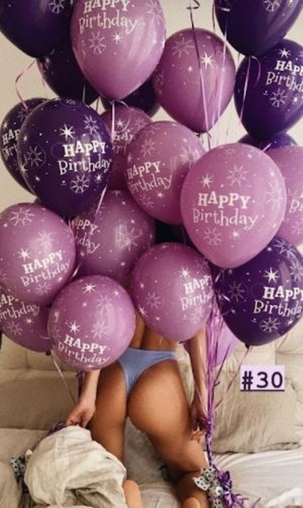 She was surrounded by balloons in the photo