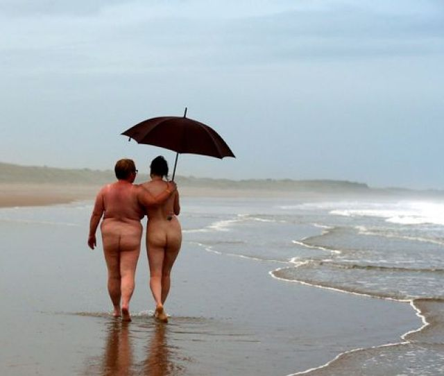 Nudists Take Part In The Annual North East Skinny Dip At Sunrise At Druridge Bay Northeast England Image Scott Heppell Afp Getty Images