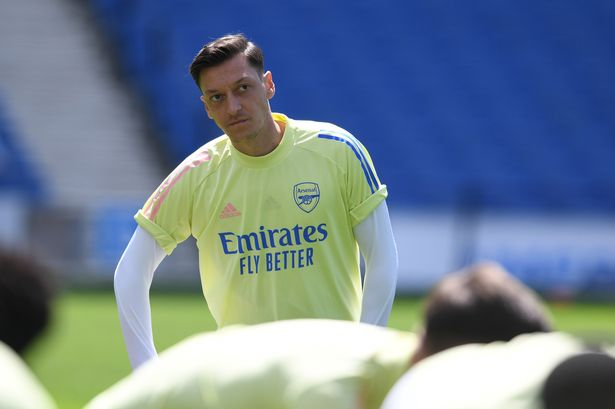 BRIGHTON, ENGLAND - JUNE 20: Arsenal substitute Mesut Ozil before the Premier League match between Brighton & Hove Albion and Arsenal FC at American Express Community Stadium on June 20, 2020 in Brighton, England. Football Stadiums around Europe remain empty due to the Coronavirus Pandemic as Government social distancing laws prohibit fans inside venues resulting in all fixtures being played behind closed doors. (Photo by Stuart MacFarlane/Arsenal FC via Getty Images)