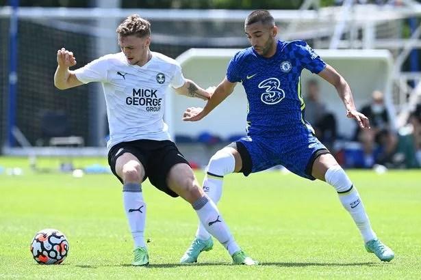 Hakim Ziyech challenges Peterborough United midfielder Jack Taylor
