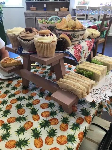 Afternoon tea served on mini picnic tables