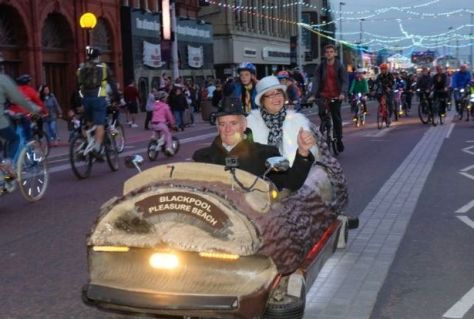 Participants at a past 'Ride the lights' events riding a Blackpool Pleasure Beach log flume