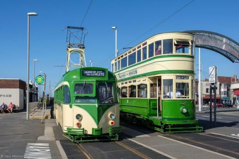 Two heritage trams near the pier in Blackpool
